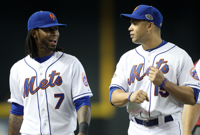 PHOENIX, AZ - JULY 12:  National League All-Star Jose Reyes #7 of the New York Mets and National League All-Star Carlos Beltran #15 of the New York Mets talk in the field during batting practice before the start of the 82nd MLB All-Star Game at Chase Fiel