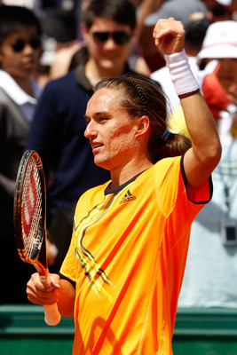 PARIS, FRANCE - MAY 24:  Alexandr Dolgopolov of Ukraine celebrates match point during the men's singles round one match between Alexandr Dolgopolov of Ukraine and Rainer Schuettler of Germany on day three of the French Open at Roland Garros on May 24, 201