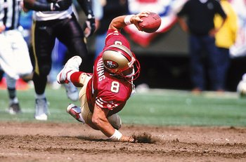 Steve Young dives for the goal
