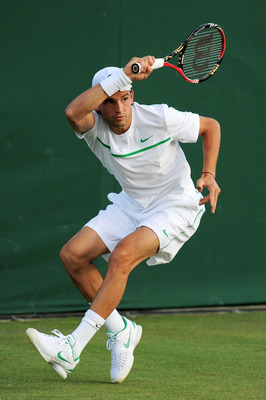 LONDON, ENGLAND - JUNE 21:  Grigor Dimitrov of Bulgaria in action during his first round match against Cedrik-Marcel Stebe of Germany on Day Two of the Wimbledon Lawn Tennis Championships at the All England Lawn Tennis and Croquet Club on June 21, 2011 in