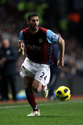 BIRMINGHAM, ENGLAND - JANUARY 22:  Carlos Cuellar of Aston Villa runs with the ball during the Barclays Premier League match between Aston Villa and Manchester City at Villa Park on January 22, 2011 in Birmingham, England.  (Photo by Ian Walton/Getty Imag