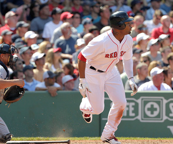 BOSTON, MA  - JULY 24:  Carl Crawford #13 of the Boston Red Sox knocks two runs in the fifth against Seattle Mariners at Fenway Park on July 24, 2011 in Boston, Massachusetts.  (Photo by Jim Rogash/Getty Images)