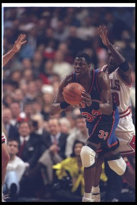 21 Jan 1997:  Center Patrick Ewing of the New York Knicks (left) looks to pass the ball as Chicago Bulls guard Michael Jordan covers him during a game at the United Center in Chicago, Illinois.  The Bulls won the game, 88-87. Mandatory Credit: Jonathan Da