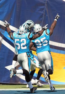 SAN DIEGO - SEPTEMBER 07:  Linebacker Jon Beason #52 and defensive end Charles Johnson #95 of the Carolina Panthers celebrate in the end zone after the Panthers returned a fumble for a touchdown against the San Diego Chargers on September 7, 2008 at Qualc