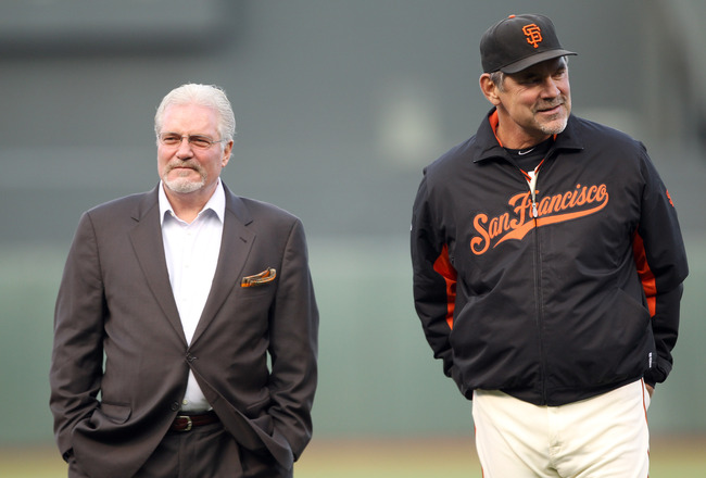 SAN FRANCISCO, CA - JUNE 09:  General manager Brian Sabean and manager Bruce Bochy stand on the field before a ceremony for Edgar Renteria #16 of the Cincinnati Reds to give him his World Series Championship ring before the Reds played the Giants at AT&T