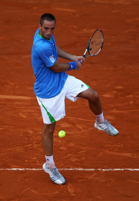 PARIS, FRANCE - MAY 30:  Victor Troicki of Serbia hits a backhand during the men's singles round four match between Andy Murray of Great Britain and Victor Troicki of Serbia on day nine of the French Open at Roland Garros on May 30, 2011 in Paris, France.