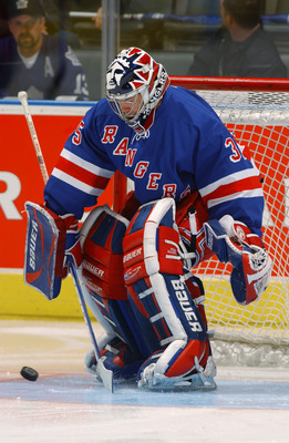 TORONTO - OCTOBER 26:  Goaltender Mike Richter #35 of the New York Rangers takes shots in warm-ups before the NHL game against the Toronto Maple Leafs on October 26, 2002 at the Air Canada Centre,Toronto, Canada.  The Rangers won 4-3.  (Photo by Dave Sand