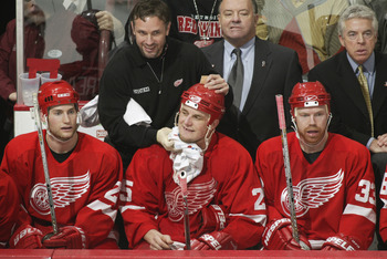 VANCOUVER - APRIL 27:  Head coach Scotty Bowman of the Detroit Red Wings stands next to his right wings - Darren McCarty #25 and right wing Kris Draper #33 - duirng game six of the Stanley Cup playoffs against the Vancouver Canucks at the General Motors P