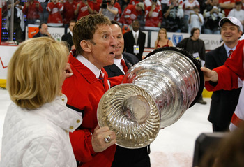 PITTSBURGH - JUNE 04:  Owner Mike Ilitch of the Detroit Red Wings celebrates with the Stanley Cup after defeating the Pittsburgh Penguins in game six of the 2008 NHL Stanley Cup Finals at Mellon Arena on June 4, 2008 in Pittsburgh. Pennsylvania. The Red W