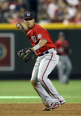 PHOENIX, AZ - JUNE 04:  Infielder Ian Desmond #6 of the Washington Nationals fields a ground ball out against the Arizona Diamondbacks during the Major League Baseball game at Chase Field on June 4, 2011 in Phoenix, Arizona.   The Diamondbacks defeated th