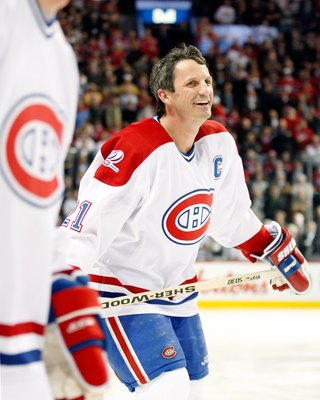 MONTREAL- DECEMBER 4:  Former Montreal Canadien Guy Carbonneau skates during the Centennial Celebration ceremonies prior to the NHL game between the Montreal Canadiens and Boston Bruins on December 4, 2009 at the Bell Centre in Montreal, Quebec, Canada.