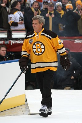 BOSTON - JANUARY 01:  Bobby Orr #4, honorary captian of the Boston Bruins, walks onto the ice before the game against the Philadelphia Flyers during the 2010 Bridgestone Winter Classic at Fenway Park on January 1, 2010 in Boston, Massachusetts.  The Bosto