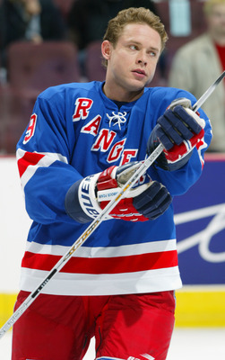 VANCOUVER - NOVEMBER 16:  Right wing Pavel Bure #9 of the New York Rangers looks on in warm ups during the NHL game against the Vancouver Canucks at General Motors Place on November 16, 2002 in Vancouver, British Columbia.  The Canucks won 3-1. (Photo by