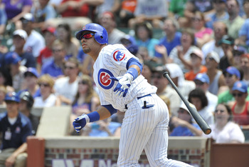 CHICAGO, IL - JULY 17:  Aramis Ramirez #16 of the Chicago Cubs hits an RBI double scoring Starlin Castro during the first inning against the Florida Marlins at Wrigley Field on July 17, 2011 in Chicago, Illinois.  (Photo by Brian Kersey/Getty Images)