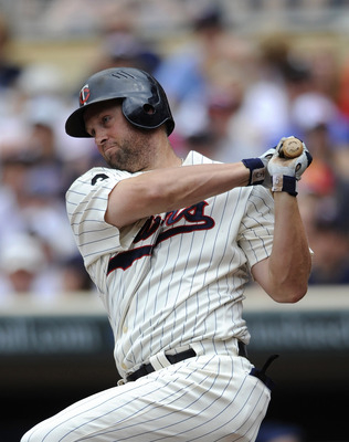 MINNEAPOLIS, MN - JULY 23: Michael Cuddyer #5 of the Minnesota Twins hits an RBI single against the Detroit Tigers in the first inning on July 23, 2011 at Target Field in Minneapolis, Minnesota. (Photo by Hannah Foslien/Getty Images)