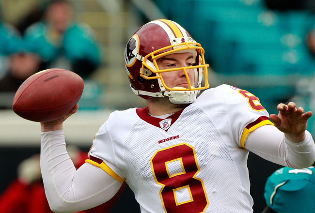 JACKSONVILLE, FL - DECEMBER 26:  Quarterback Rex Grossman #8 of the Washington Redskins attempts a pass during the game against the Jacksonville Jaguars at EverBank Field on December 26, 2010 in Jacksonville, Florida.  (Photo by Sam Greenwood/Getty Images