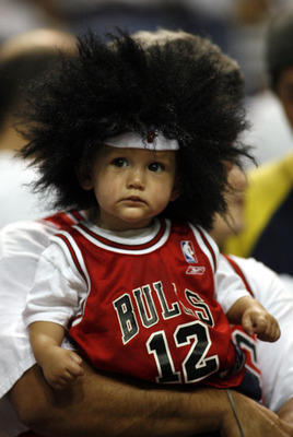MIAMI - APRIL 29:  A young Chicago Bulls Fan watches them play the Miami Heat in Game Four of the Eastern Conference Quarterfinals during the 2007 NBA Playoffs at American Airlines Arena April 29, 2007 in Miami, Florida. Chicago beat Miami 92-79. NOTE TO