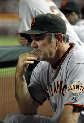 PHOENIX, AZ - JUNE 15:  Manager Bruce Bochy of the San Francisco Giants in the dugout during the Major League Baseball game against the Arizona Diamondbacks at Chase Field on June 15, 2011 in Phoenix, Arizona. The Giants defeated the Diamondbacks 5-2.  (P