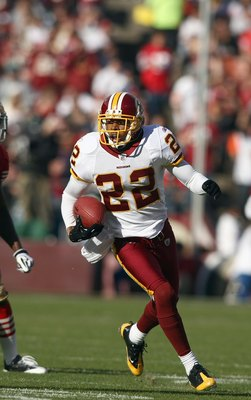 SAN FRANCISCO - DECEMBER 28:  Carlos Rogers #22 of the Washington Redskins carries the ball during the game against of the San Fransisco 49ers at Candlestick Park on December 28, 2008 in San Francisco, California. (Photo by: Jonathan Ferrey/Getty Images)