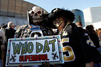 NEW ORLEANS - JANUARY 24:  Fans of the New Orleans Saints hold up a sign which reads 'Who Dat Super Bowl' in support of the Saints outside the stadium against the Minnesota Vikings during the NFC Championship Game at the Louisana Superdome on January 24,
