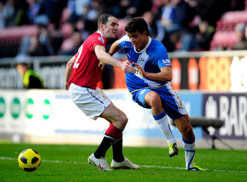 WIGAN, ENGLAND - FEBRUARY 26:  Franco Di Santo of Wigan Athletic battles for the ball with John O' Shea of Manchester United during the Barclays Premier League match between Wigan Athletic and Manchester United at the DW Stadium on February 26, 2011 in Wi