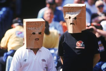 3 Oct 1999: Fans of the Cincinnati Bengals wear unhappy paper bag faces crying about the Cincinnati Reds worst season during a game against the St. Louis Rams at the Riverfront Stadium in Cincinnati, Ohio. The Rams defeated the Bengals 38-10. Mandatory Cr