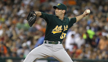 DETROIT, MI - JULY 20:  Relief pitcher Grant Balfour #50 of the Oakland Athletics throws in the eighth inning against the Detroit Tigers during an MLB game at Comerica Park on July 20, 2011 in Detroit, Michigan. The Athletics won 7-5.  (Photo by Dave Regi