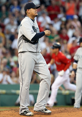 BOSTON, MA - JULY 22:  Felix Hernandez #34 of the Seattle Mariners reacts after giving up a solo home run to Jacoby Ellsbury #2 of the Boston Red Sox in the third inning on July 22, 2011 at Fenway Park in Boston, Massachusetts.  (Photo by Elsa/Getty Image