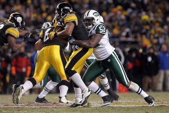 PITTSBURGH, PA - JANUARY 23:  David Harris #52 of the New York Jets makes a tackle against the Pittsburgh Steelers during the 2011 AFC Championship game at Heinz Field on January 23, 2011 in Pittsburgh, Pennsylvania.  (Photo by Nick Laham/Getty Images)