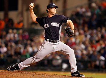 SARASOTA, FL - MARCH 07:  Pitcher Adam Warren #88 of the New York Yankees pitches against the Baltimore Orioles during a Grapefruit League Spring Training Game at Ed Smith Stadium on March 7, 2011 in Sarasota, Florida.  (Photo by J. Meric/Getty Images)