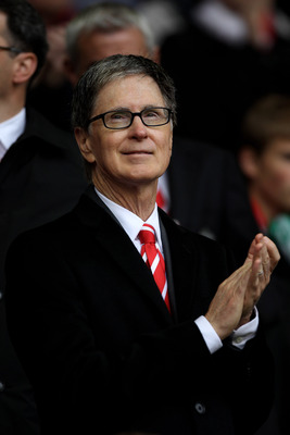 LIVERPOOL, ENGLAND - MAY 15:  Liverpool co-owner John W Henry applauds the players during the Barclays Premier League match between Liverpool and Tottenham Hotspur at Anfield on May 15, 2011 in Liverpool, England.  (Photo by Michael Steele/Getty Images)