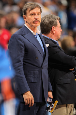 DENVER, CO - APRIL 23:  Stan Kroenke, owner of the Denver Nuggets watches his team from courtside seats as they face the Oklahoma City Thunder in Game Three of the Western Conference Quarterfinals in the 2011 NBA Playoffs on April 23, 2011 at the Pepsi Ce