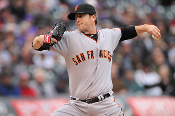 DENVER, CO - APRIL 20:  Relief pitcher Dan Runzler #45 of the San Francisco Giants delivers against the Colorado Rockies at Coors Field on April 20, 2011 in Denver, Colorado.  (Photo by Doug Pensinger/Getty Images)