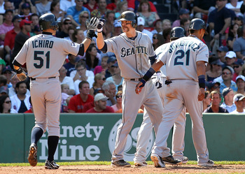BOSTON, MA  - JULY 24: Brendan Ryan #26 of the Seattle Mariners celebrates his home run with teammate Ichiro Suzuki #51 of the Seattle Mariners during a game against the Boston Red Sox at Fenway Park on July 24, 2011 in Boston, Massachusetts.  (Photo by J