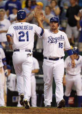 KANSAS CITY, MO - JULY 19:  Jeff Francoeur #21 of the Kansas City Royals is congratulated by Billy Butler #16 after both scored during the 6th inning of the game against the Chicago White Sox on July 19, 2011 at Kauffman Stadium in Kansas City, Missouri.