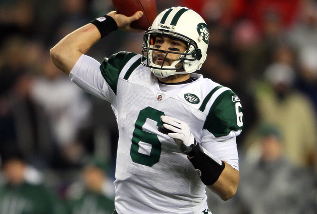 FOXBORO, MA - JANUARY 16:  Mark Sanchez #6 of the New York Jets drops back against the New England Patriots during their 2011 AFC divisional playoff game at Gillette Stadium on January 16, 2011 in Foxboro, Massachusetts.  (Photo by Elsa/Getty Images)
