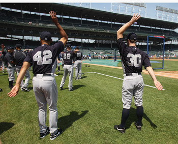CHICAGO, IL - JUNE 17: Mariano Rivera #42 and David Robertson #30 of the New York Yankees stretch during batting practice before a game against the Chicago Cubs at Wrigley Field on June 17, 2011 in Chicago, Illinois. (Photo by Jonathan Daniel/Getty Images