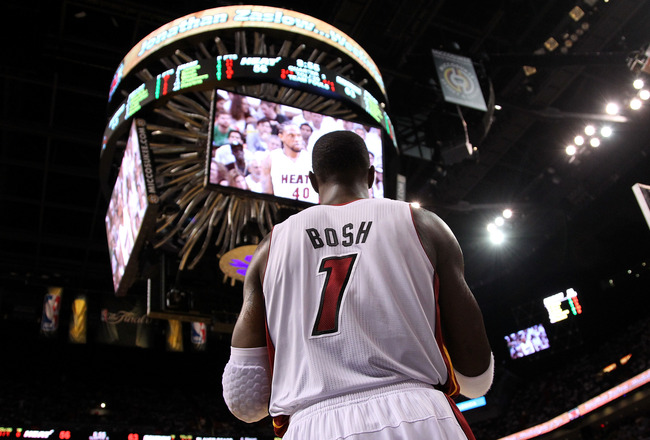 MIAMI, FL - JUNE 12:  Chris Bosh #1 of the Miami Heat looks on against the Dallas Mavericks in Game Six of the 2011 NBA Finals at American Airlines Arena on June 12, 2011 in Miami, Florida. NOTE TO USER: User expressly acknowledges and agrees that, by dow