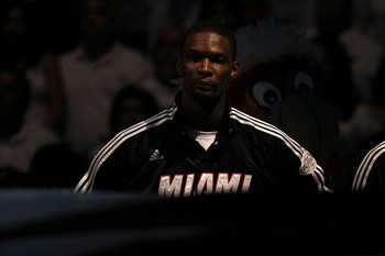 MIAMI, FL - JUNE 12:  Chris Bosh #1 of the Miami Heat stands for the performance of the National Anthem against the Dallas Mavericks in Game Six of the 2011 NBA Finals at American Airlines Arena on June 12, 2011 in Miami, Florida. NOTE TO USER: User expre