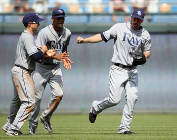 KANSAS CITY, MO - JULY 24:  Outfielders Sam Fuld #5, Desmond Jennings #8, and Matt Joyce #20 of the Tampa Bay Rays celebrate after the Rays defeated the Kansas City Royals 5-0 to win the game on July 24, 2011 at Kauffman Stadium in Kansas City, Missouri.