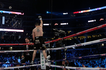 ARLINGTON, TX - NOVEMBER 13:  Brandon Rios (brown trunks) celebrates after he won his match against Omri Lowther during their Super Lightweight bout at Cowboys Stadium on November 13, 2010 in Arlington, Texas.  (Photo by Nick Laham/Getty Images)