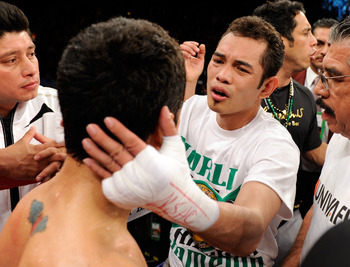 LAS VEGAS, NV - FEBRUARY 19:  Nonito Donaire (R) of the Philippines checks on Fernando Montiel of Mexico after Donaire won their WBC/WBO bantamweight championship bout by second-round TKO at the Mandalay Bay Events Center February 19, 2011 in Las Vegas, N