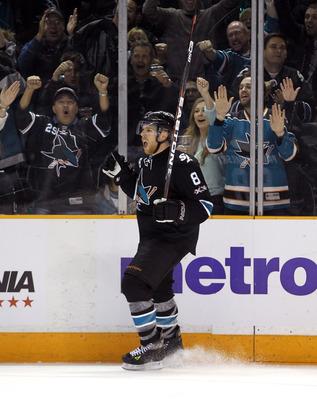 SAN JOSE, CA - APRIL 29:  Joe Pavelski #8 of the San Jose Sharks celebrates after he made a goal in the third period to tie their game against the Detroit Red Wings in Game One of the Western Conference Semifinals during the 2011 NHL Stanley Cup Playoffs