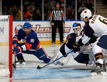UNIONDALE, NY - MARCH 24:  Goalie Chris Mason #50 of the Atlanta Thrashers looks back to see John Tavares #91 of the New York Islanders shoot the puck into the empty net during the second period of an NHL hockey game at the Nassau Coliseum on March 24, 20