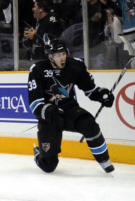 SAN JOSE, CA - APRIL 14: Logan Couture #39 of the San Jose Sharks celebrates after scoring a goal against the Los Angeles Kings in Game One of the Western Conference Quarterfinals  during the 2011 NHL Stanley Cup Playoffs at the HP Pavilion on April 14, 2