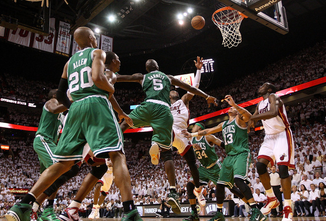 MIAMI, FL - MAY 11:  Dwyane Wade #3 of the Miami Heat shoots over Kevin Garnett #5 of the Boston Celtics during Game Five of the Eastern Conference Semifinals of the 2011 NBA Playoffs at American Airlines Arena on May 11, 2011 in Miami, Florida. NOTE TO U