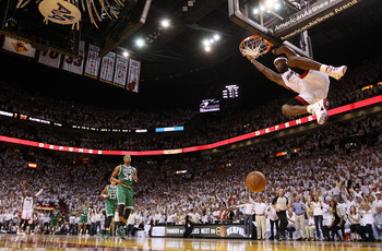 MIAMI, FL - MAY 11:  LeBron James #6 of the Miami Heat makes a late 4th quarter dunk during Game Five of the Eastern Conference Semifinals of the 2011 NBA Playoffs against the Boston Celtics at American Airlines Arena on May 11, 2011 in Miami, Florida. NO