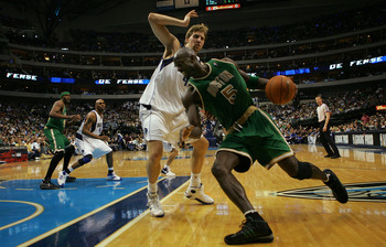 DALLAS - MARCH 20:  Kevin Garnett #5 of the Boston Celtics moves the ball against Dirk Nowitzki #41 of the Dallas Mavericks on March 20, 2008 at American Airlines Center in Dallas, Texas.  NOTE TO USER: User expressly acknowledges and agrees that, by down