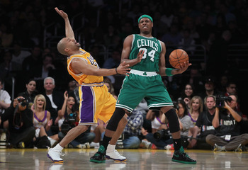 LOS ANGELES, CA - JANUARY 30:  Paul Pierce #34 of the Boston Celtics is defended by Derek Fisher #2 of the Los Angeles Lakers in the first half at Staples Center on January 30, 2011 in Los Angeles, California. The Celtics defeated the Lakers 109-96.  (Pho