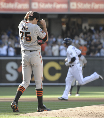 SAN DIEGO, CA - JULY 16: Barry Zito #75 of the San Francisco Giants steps off the mound as Jesus Guzman #15 of the San Diego Padres rounds the bases after hitting a three-run homer during the first inning of a baseball game at Petco Park on July 16, 2011
